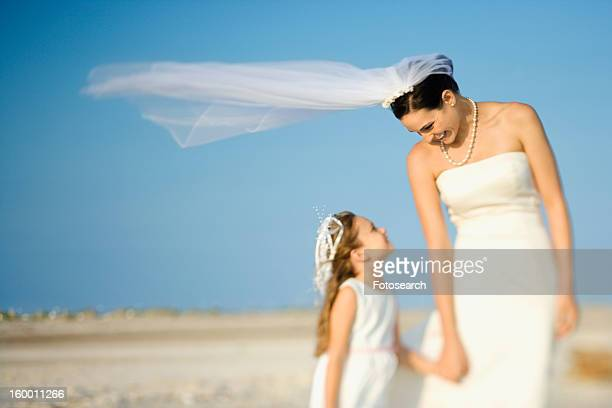 bride and flower girl on beach - beautiful wife pics stock pictures, royalty-free photos & images