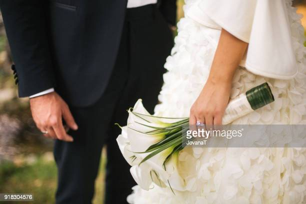 Bride and groom and her white calla bouquet