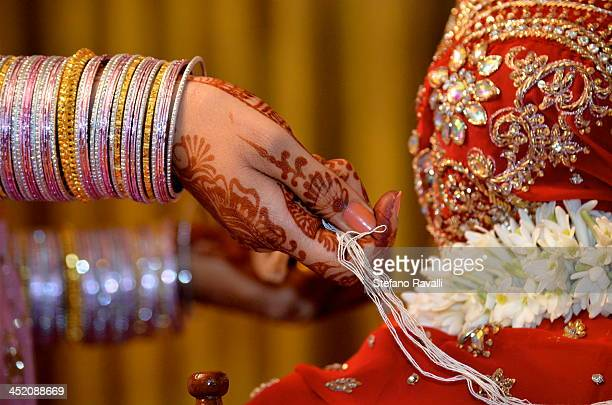 Bride and groom are symbolically tied together during the traditional Hindu ceremony.