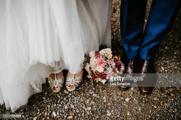 bride and groom at a wedding - married stock-fotos und bilder