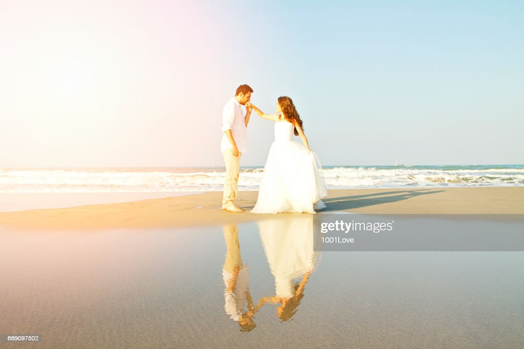 Bride and groom at beach : Stock Photo