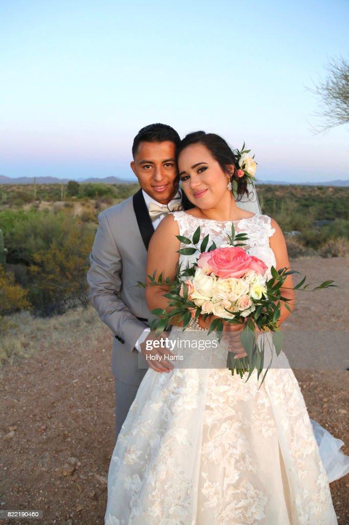 Bride and groom at desert wedding, formal portrait at dusk : Stock Photo