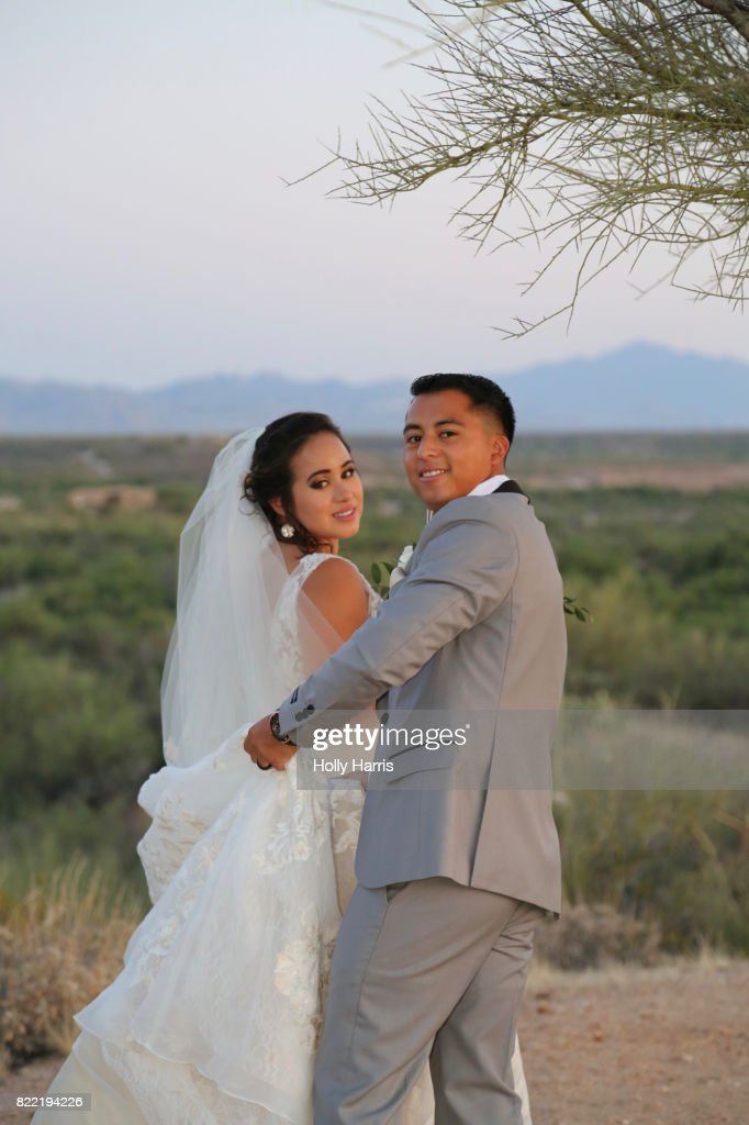 Bride and groom at desert wedding, formal portrait at dusk : Stock Photo