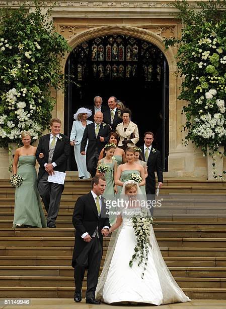 Bride and groom, Autumn Kelly and Peter Phillips walk hand in hand after their wedding ceremony at St George's Chapel, in Windsor Castle on May 17,...