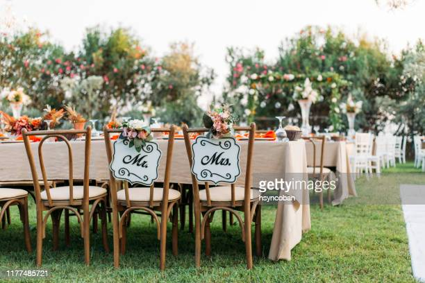 bride and groom chair at wedding reception - wedding stock pictures, royalty-free photos & images