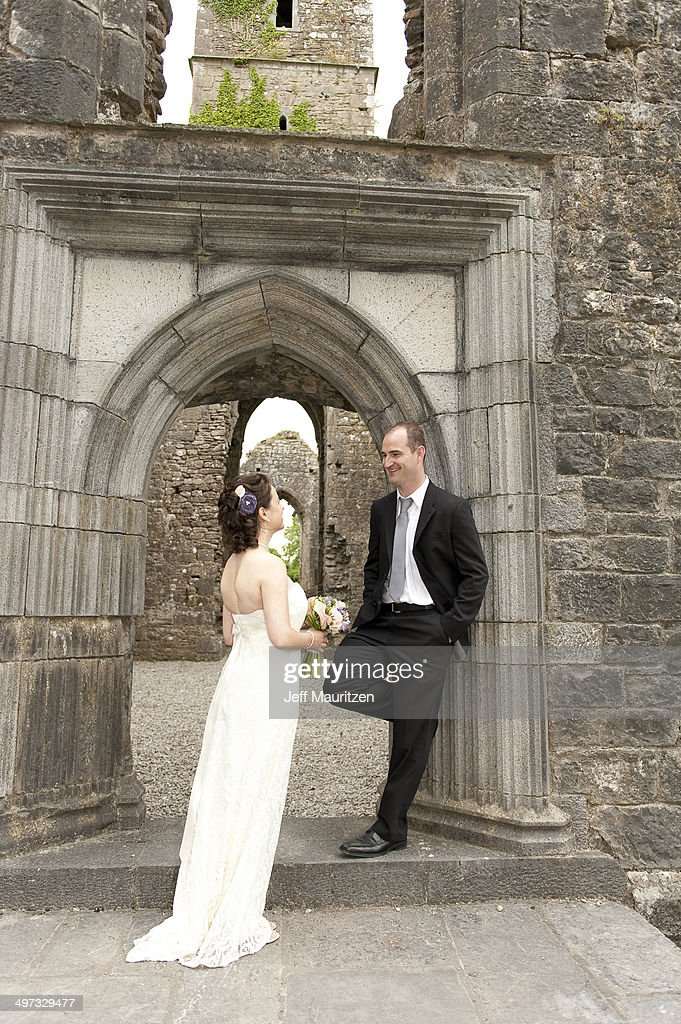 134a9eae3187 A Bride And Groom Converse At The Entrance The Ruin Moore Abbey ...