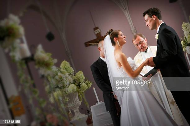 bride and groom couple at the alter during wedding ceremony - wedding vows stock pictures, royalty-free photos & images