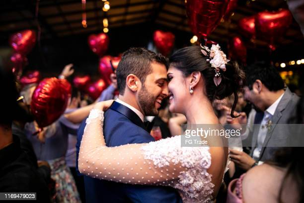 bride and groom dancing during their wedding party - matrimonio foto e immagini stock