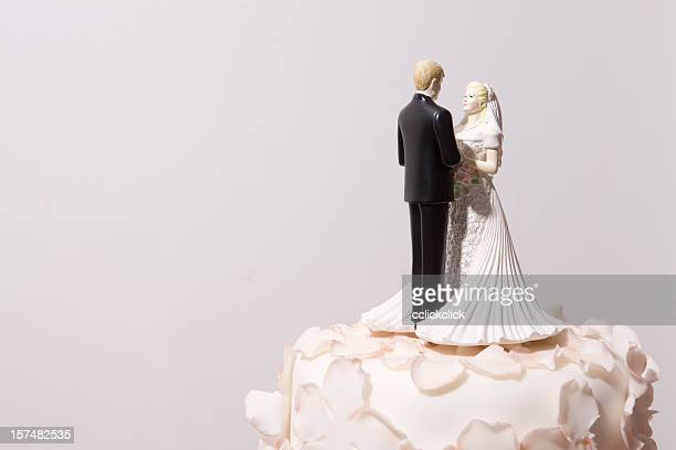 Bride and groom decorations on top of a wedding cake