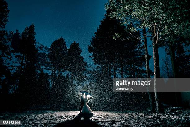 Bride and Groom Embracing in the forest during a storm
