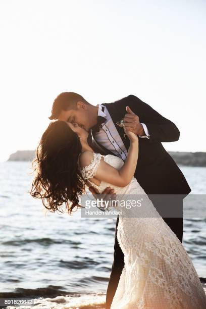 bride and groom, enjoying amazing sunset - wedding ceremony stock photos and pictures