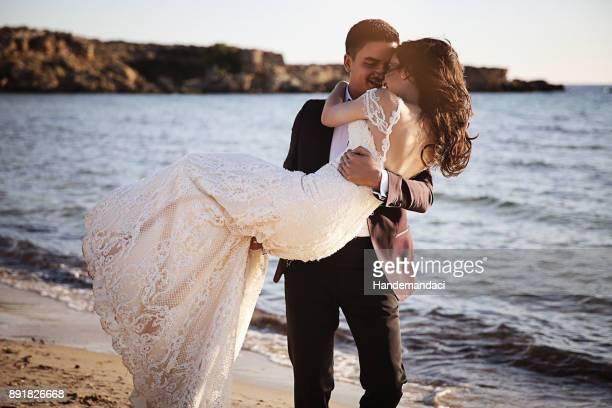 bride and groom, enjoying amazing sunset - wedding ceremony stock pictures, royalty-free photos & images