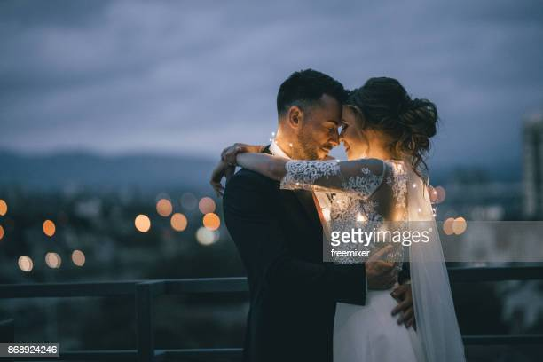 bride and groom enjoying in their love - matrimonio foto e immagini stock