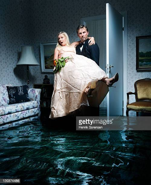 bride and groom entering flooded room