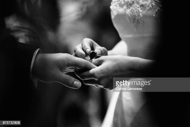 Bride and Groom exchange wedding rings/bands at their wedding