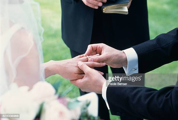 bride and groom exchanging rings - married stock pictures, royalty-free photos & images