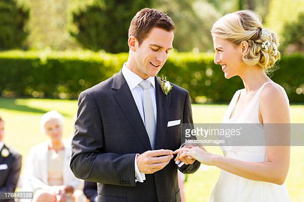 bride and groom exchanging wedding ring - wedding vows stock pictures, royalty-free photos & images