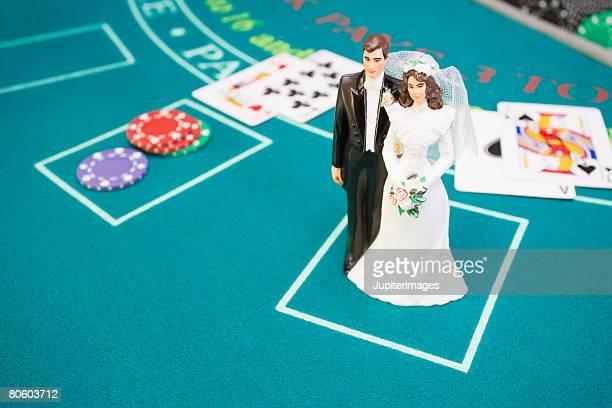 Bride and groom figurine on betting table