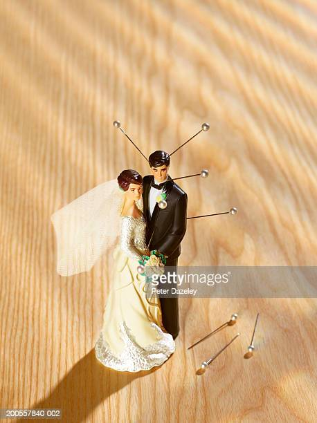 bride and groom figurine with sticking out pins, high angle view - revenge stock pictures, royalty-free photos & images
