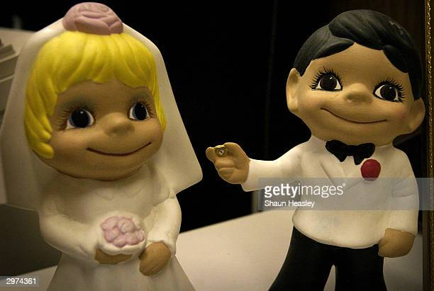 Bride and groom figurines sit on the counter at the Dane County Clerk's office February 12 2004 in Madison Wisconsin The Wisconsin State Legislature...