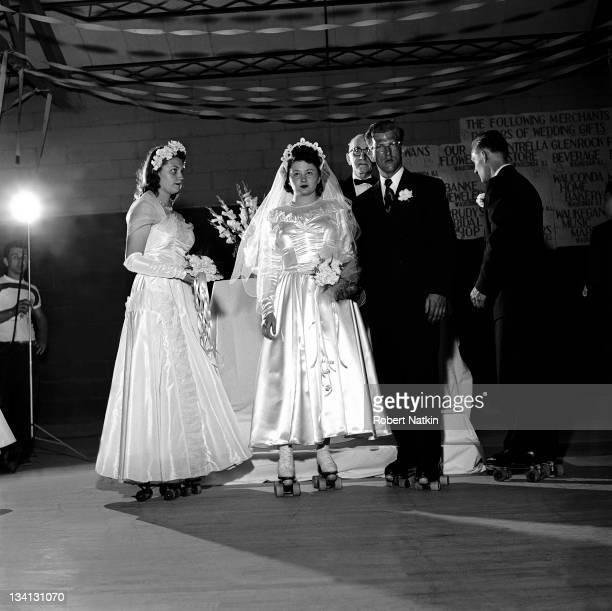A bride and groom flanked by their best man and maid of honor all stand on roller skates during a wedding ceremony in Chicago 1951