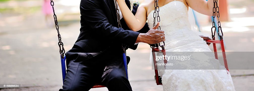 bride and groom holding hands : Stock Photo