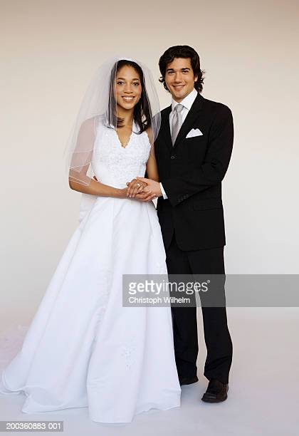 bride and groom holding hands, portrait - bridegroom stock pictures, royalty-free photos & images