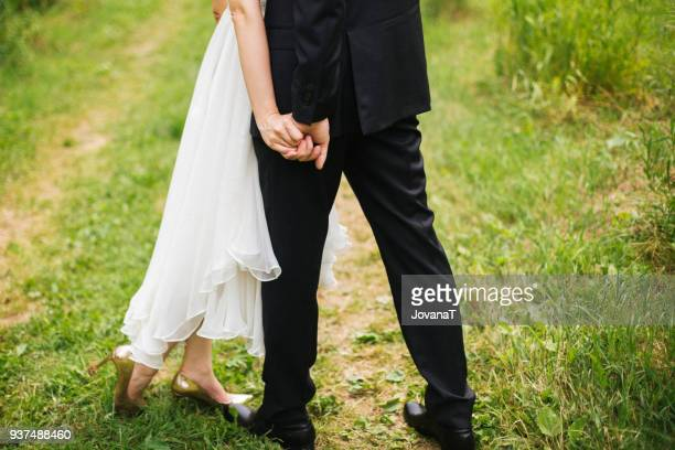Bride and groom holding hands with strong squeeze