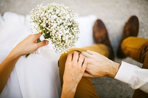 Bride and groom holding their hands together - gettyimageskorea