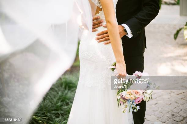 bride and groom hugging - bride stock pictures, royalty-free photos & images