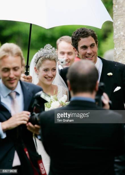 Bride and groom Hugh Van Cutsem Junior and Rose Astor arrive at their society wedding at Burford Parish Church on June 4 2005 in Burford England