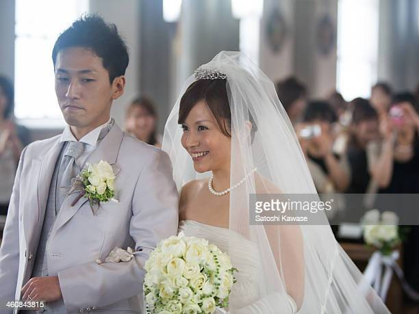 bride and groom in a church - wedding ceremony stock photos and pictures