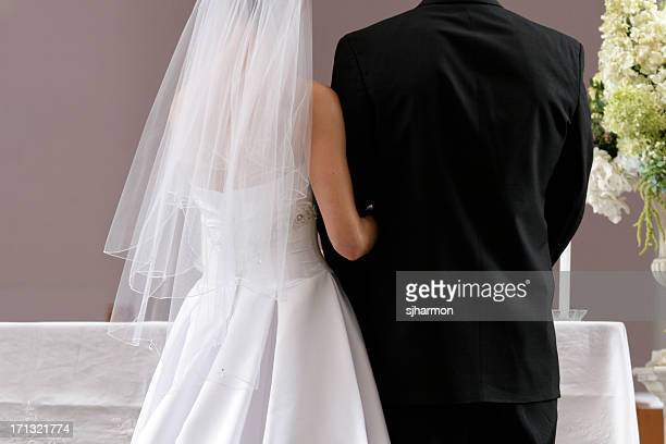 Bride and Groom In Church at Wedding Ceremony Taking Communion