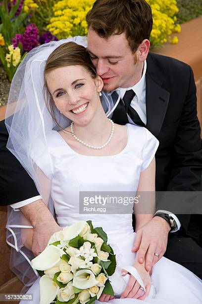bride and groom in garden - rich_legg stock photos and pictures