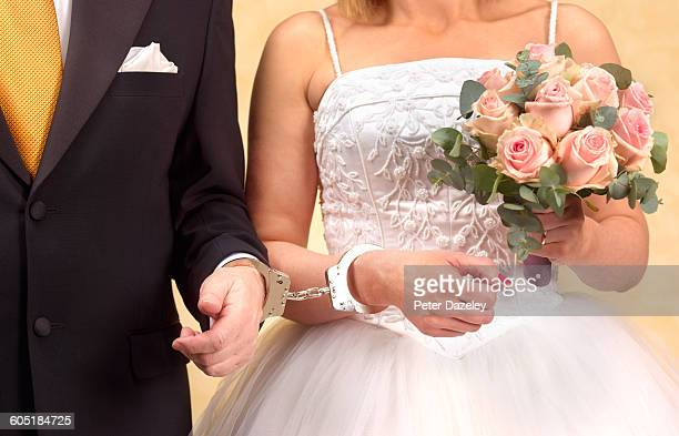 bride and groom in handcuffs - 69 position stock photos and pictures