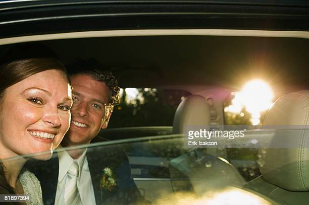 bride and groom in limousine - utah wedding stock pictures, royalty-free photos & images