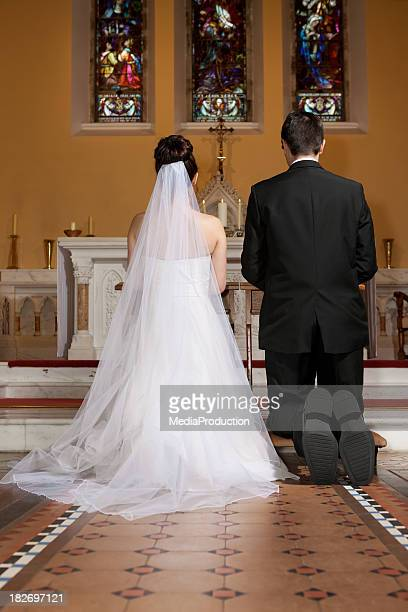 bride and groom in the church - catholicism stock pictures, royalty-free photos & images