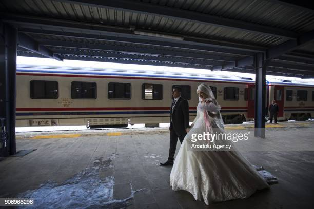 A bride and groom is seen on a station on Eastern Express' route which travels from Ankara to Kars in Kars Turkey on January 13 2018 With the...