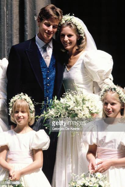 Bride and groom Julia Rawlinson and James Ogilvy pose with their bridesmaids Lady Gabriella Windsor and Alexandra Wilson during their wedding at St...