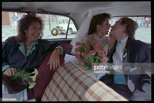 Bride and Groom Kissing in Car