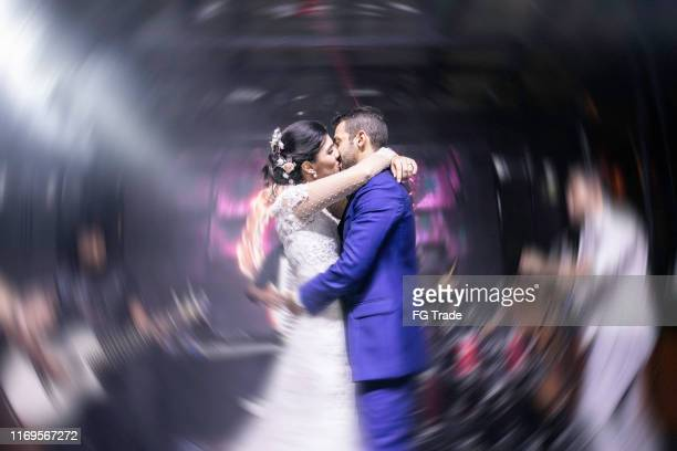 bride and groom kissing in the dance floog - drunk wife at party stock pictures, royalty-free photos & images