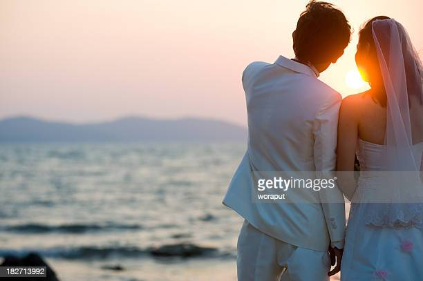 bride and groom kissing on the beach