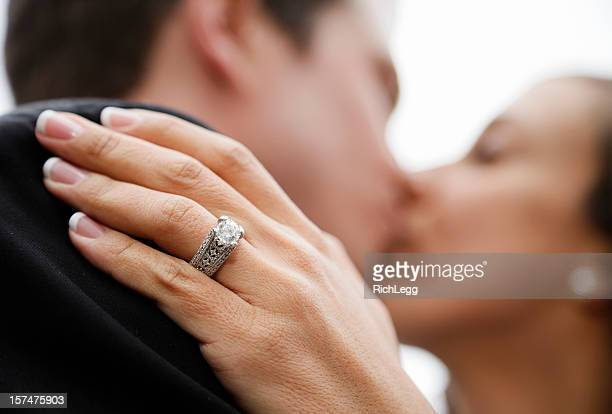 bride and groom kissing - wedding ring stock pictures, royalty-free photos & images