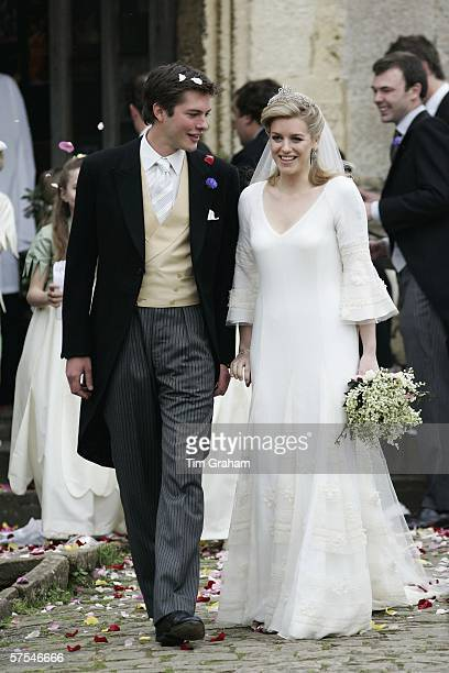 Bride and groom Laura ParkerBowles and Harry Lopes are covered in confetti at their wedding ceremony at St Cyriac's Church Lacock on May 6 2006 in...