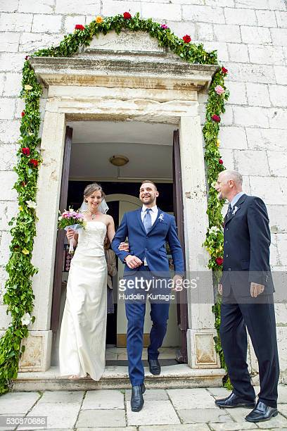bride and groom leaving chapel - church wedding decorations stock pictures, royalty-free photos & images