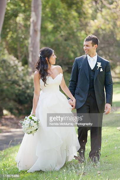 bride and groom looking at each other in outdoors - lebanese ethnicity stock photos and pictures