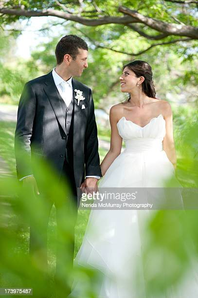 Bride and Groom looking at each other in outdoors