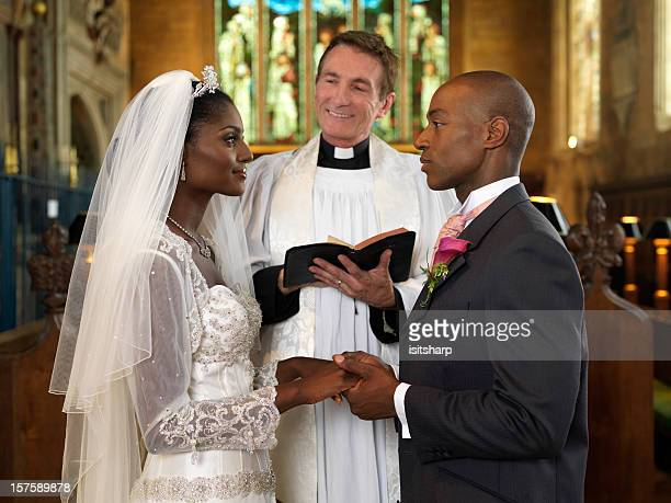 bride and groom - priest stock pictures, royalty-free photos & images