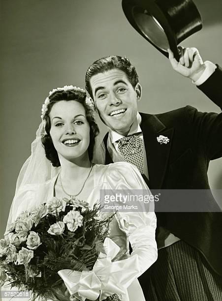 Bride and Groom posing in studio, (B&W), portrait