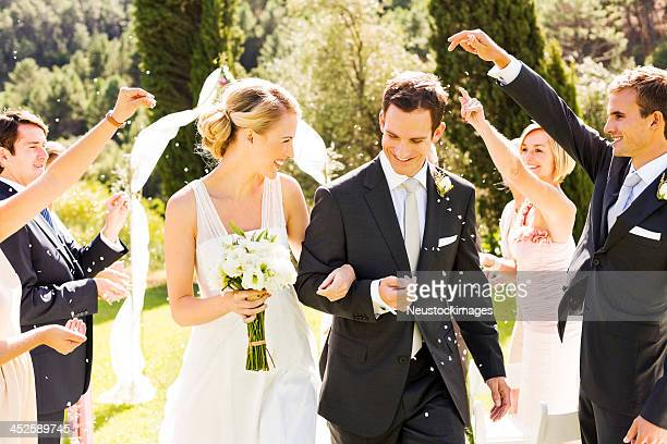 bride and groom procession after wedding - wedding ceremony stock photos and pictures